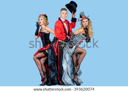 two pretty young blonde girls with men in formal retro clothes dancing Broadway style, isolated - stock photo