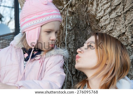 Two Pretty young girl walks on farm