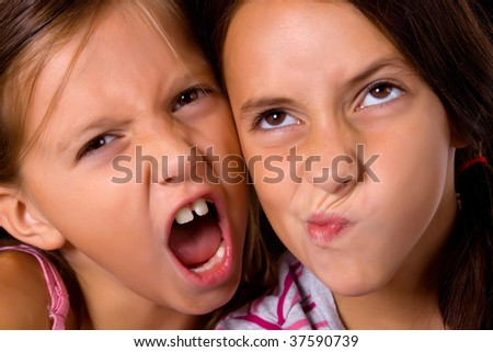 Two pretty young girls making funny faces