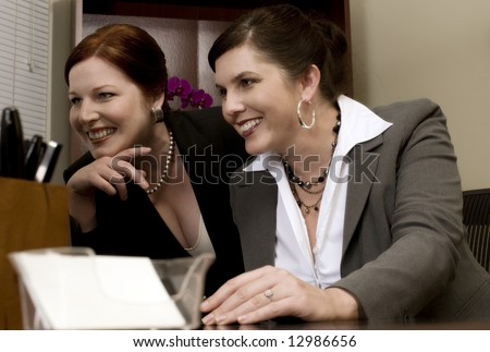 Two Problem-Solving Corporate Co-Workers - stock photo
