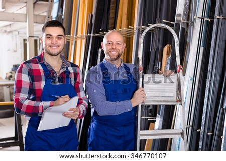 Two production workers in coverall with different PVC window