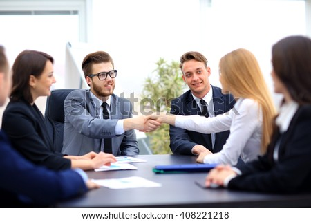 Two professional business people shaking hands