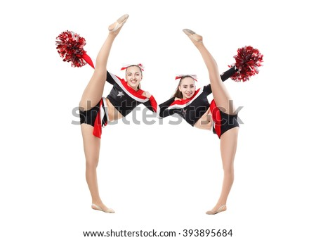 Two professional cheerleaders posing at studio. Vertical split. Isolated over white. - stock photo