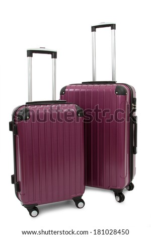 two purple suitcase isolated on white background  - stock photo