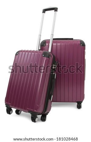 two purple suitcase isolated on white background  - stock photo