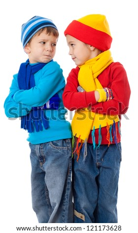 Two quarreling kids in winter clothes, isolated on white - stock photo