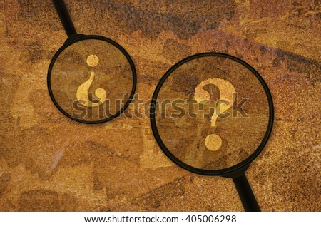 Two question marks under magnifiers on grunge background - stock photo