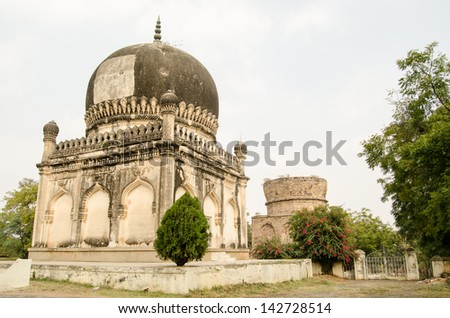 Two Qutub Shahi tombs built in the Mughal Empire at Golconda, Hyderabad.  The Sultan who was to occupy the rear mausoleum died many miles from home and so the Mirza was unfinished. - stock photo