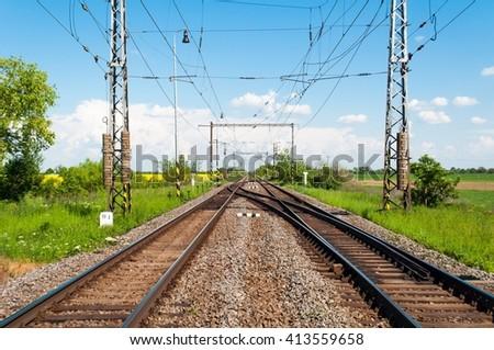 Two railway tracks in a rural scene - stock photo