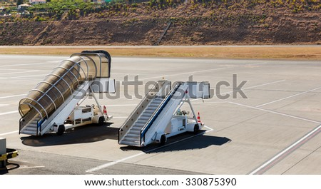 Two ramps standing on the airfield - stock photo