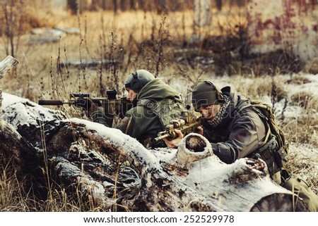 two rangers in an ambush aim at the enemy