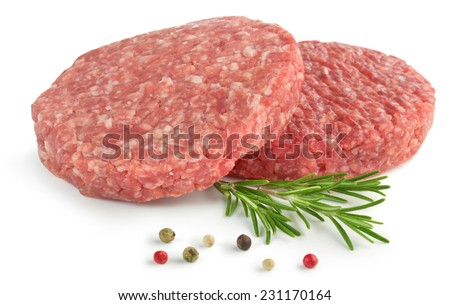 two raw hamburger, rosemary and pepper on white background - stock photo