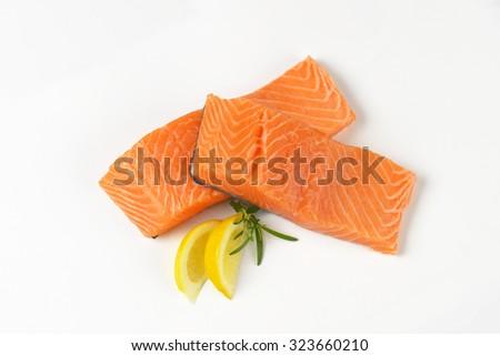 two raw salmon fillets on white background - stock photo