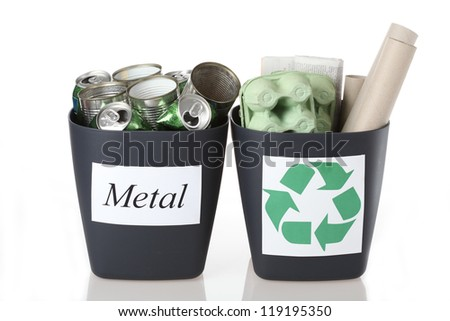 Two recyclable bins: metal tins and paper - stock photo