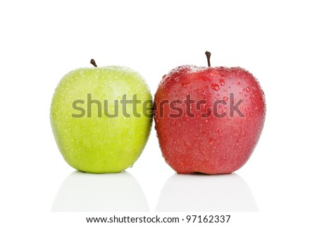Two red and green apples in water droplets. White background. Isolated.