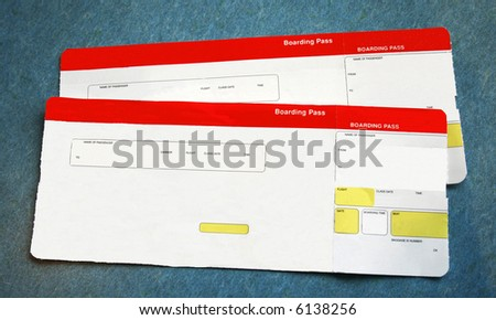 two red and white boarding passes. Information is removed - stock photo