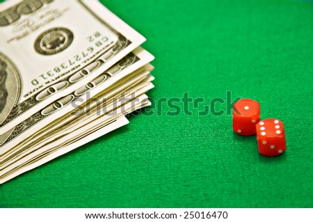 two red bones on green cloth - stock photo