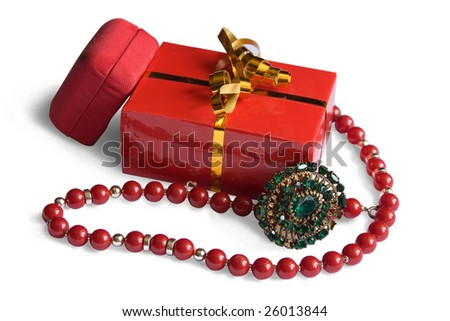 two red boxes and brooch with beads