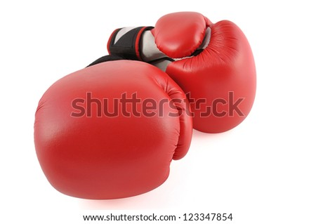 Two red boxing gloves in white background