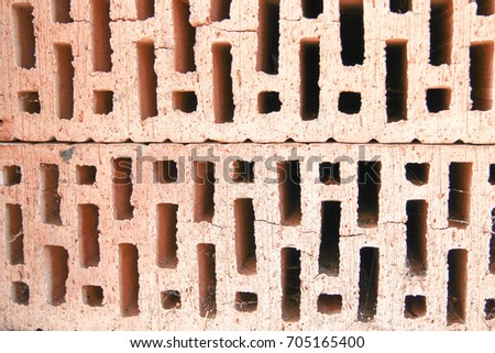 Two red bricks prepared for construction, close up