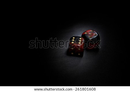 Two red casino dices on the black background - stock photo