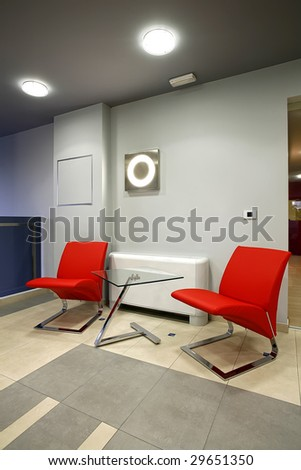 two red chairs in waiting room