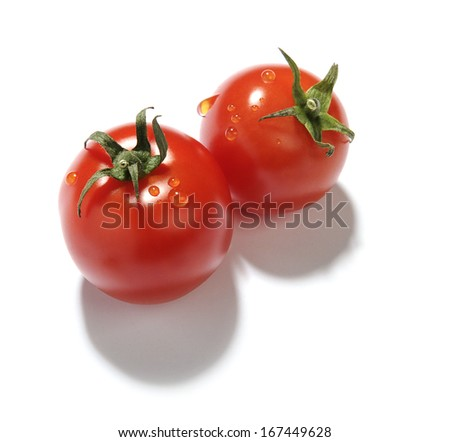 two red cherry tomatoes with water droplets on white background   - stock photo