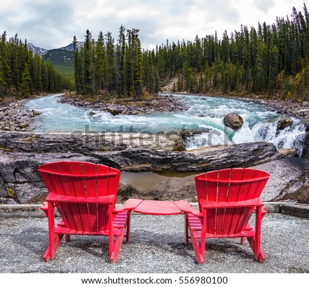 two red deckchairs stand on shore stock photo royalty free