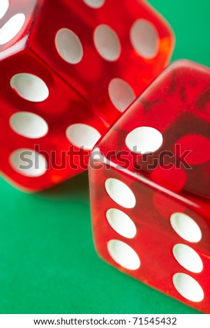 Two red dices on green background. Close-up. - stock photo