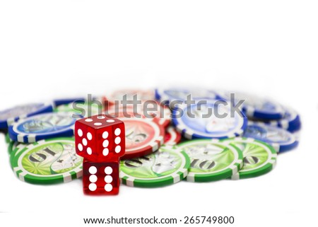 Two red dices with poker chips on the background.  - stock photo