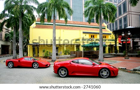 Two Red Ferraries in Chinatown of  Singapore - stock photo