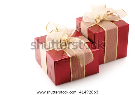 Two red foil gifts with gold translucent bows isolated on white background.