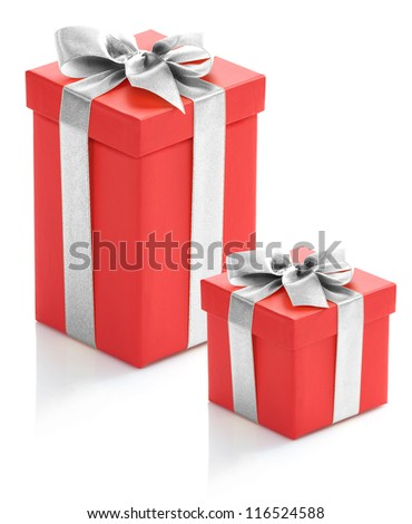 Two red gift boxes with silver ribbon on white background. - stock photo