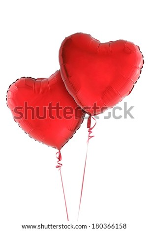 Two red heart balloons on white - stock photo