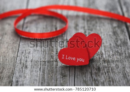 Two red heart on wood background. Closeup