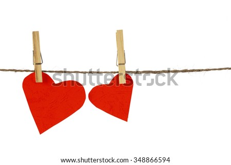 two red hearts hang on clothespin isolated on white background - stock photo