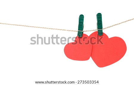 Two red hearts hanging on rope with clothespins, isolated on white. - stock photo