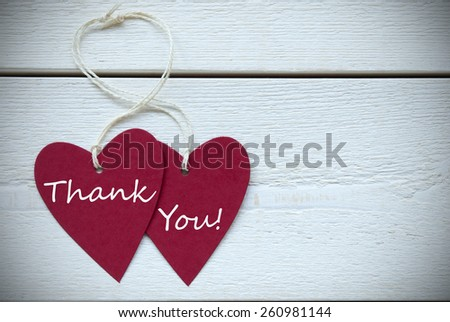 Two Red Hearts Label With White Ribbon On White Wooden Background With English Text Thank You Vintage Retro Or Rustic Style With Frame - stock photo
