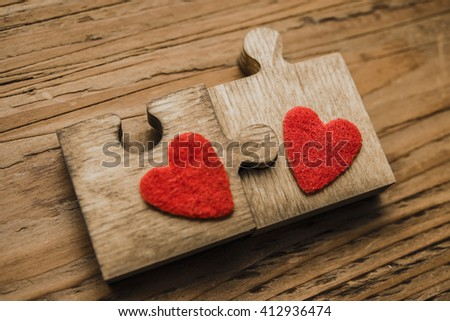 Two red hearts lie wooden puzzle on table texture background. idea, sign, symbol, concept of true romantic passion, couple in love, sex - stock photo