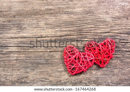 Two red hearts on wooden background - stock photo