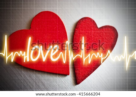 Two red hearts with EKG curve and LOVE text - saint Valentines day - stock photo