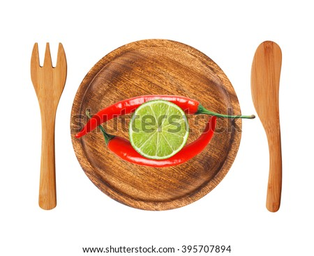 Two red hot chilli peppers and lime slice on wooden plate isolated on white - stock photo