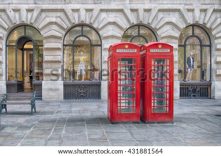 two red phone boxes booths on the street in Central London