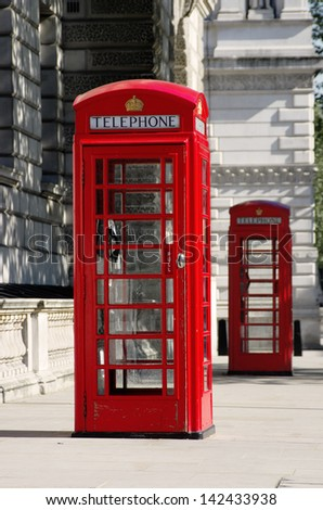 two red phone boxes old style in London in row (shallow depth of field) - stock photo