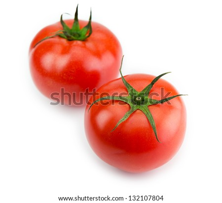 Two red ripe tomato with long sepal leaves still intact.Isolated on white. - stock photo