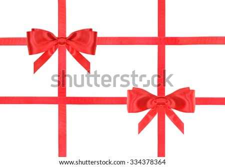 two red satin bows and four intersecting ribbons isolated on horizontal white background