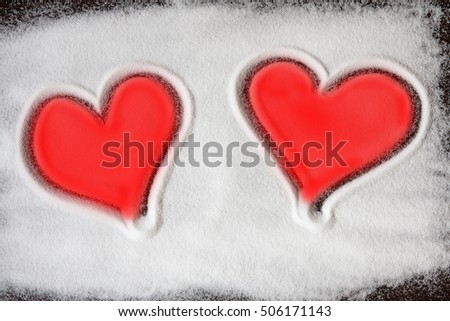 Two red shape of hearts made out of salt