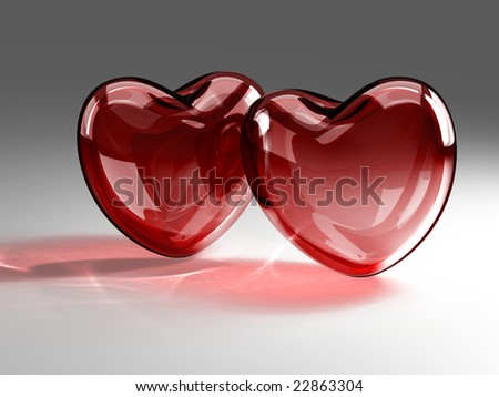 Two red tint glass hearts - stock photo