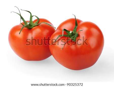 Two red tomatoes on white background - stock photo