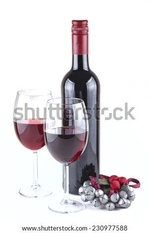 Two red wine glasses and Christmas ornament isolated on white, shallow focus - stock photo